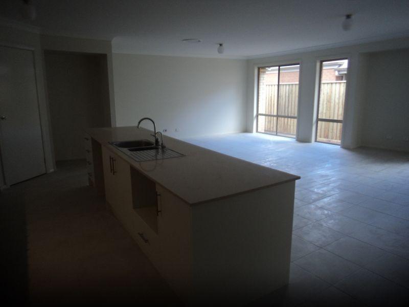 23 Honeysuckle Drive, Aberglasslyn NSW 2320